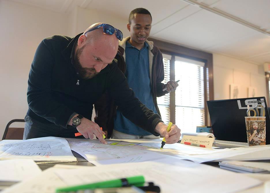 William Doran and Giovanni Coakley working on the project, hattiesburg arts council