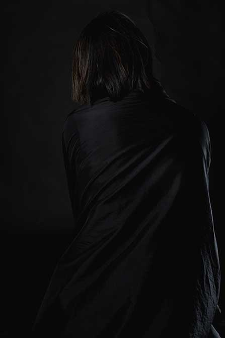 Dark image of cloaked figure. lsu photography student work