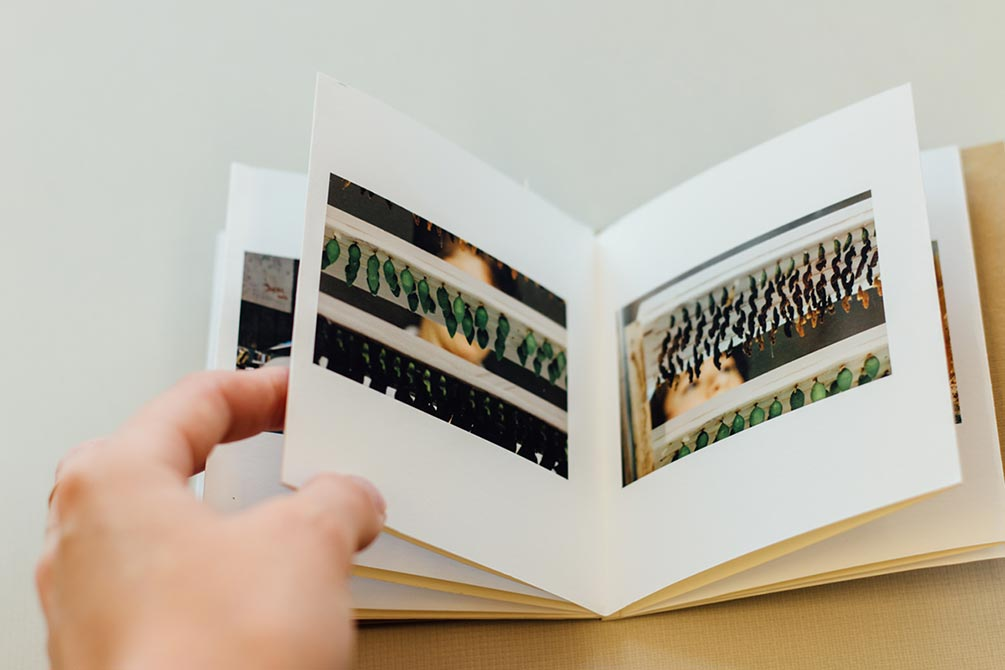 hand turning book pages. lsu photography student work
