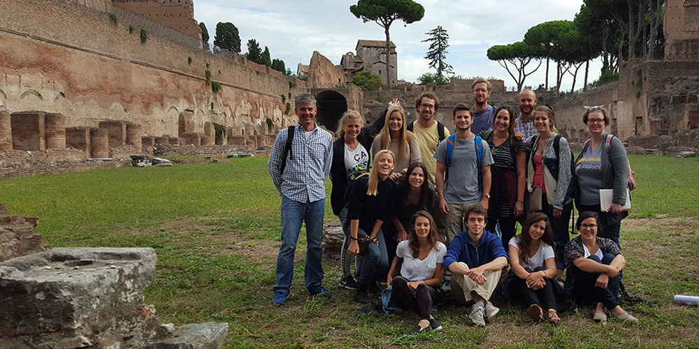lsu rome program students by ruins