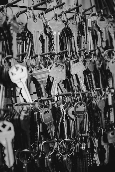 Dozens of keys hang from rows of nails