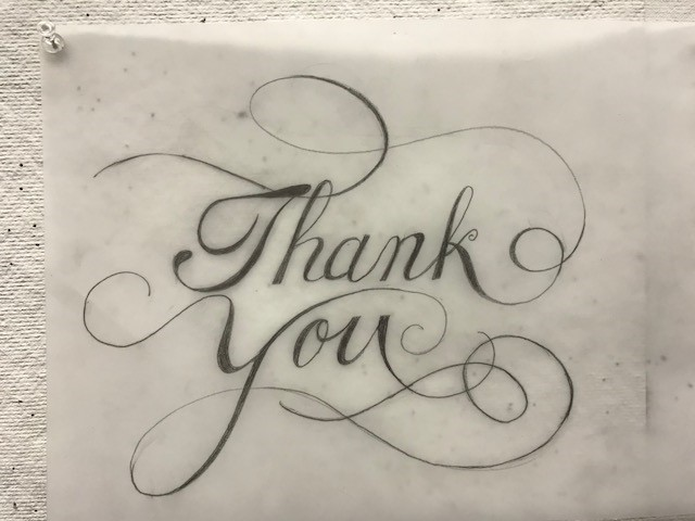 "calligraphy ""thank you"" with swirls"