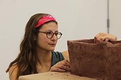 Grace Tessein works on ceramics