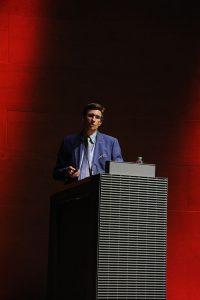 Professor Darius Spieth speaks at the Louvre