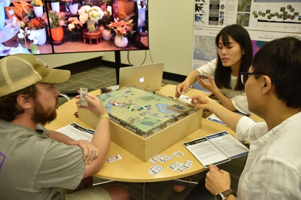 Playing the game about tourism development and sea level rise.