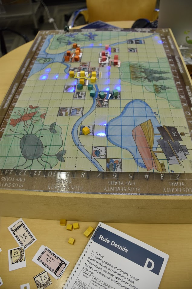 Their board game visualized sea level rise with Arduino controlled LEDs.