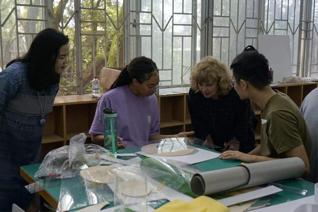Professor Cuddeback (second from right) during workshop helping students