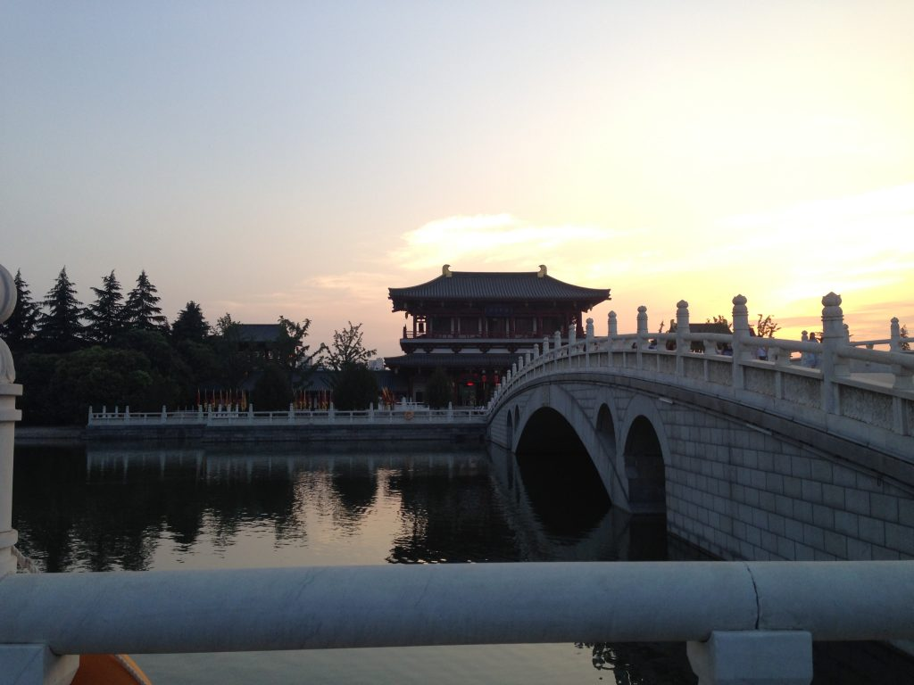 LSU student exploring Chinese architecture at sunset