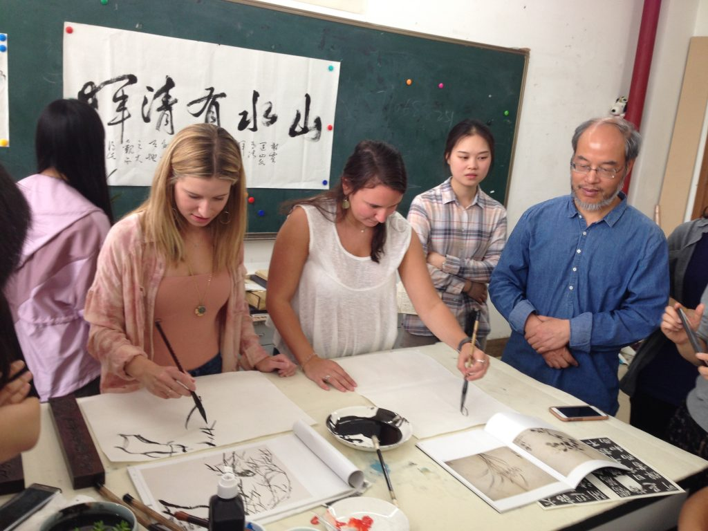 Practicing traditional Chinese painting and calligraphy.