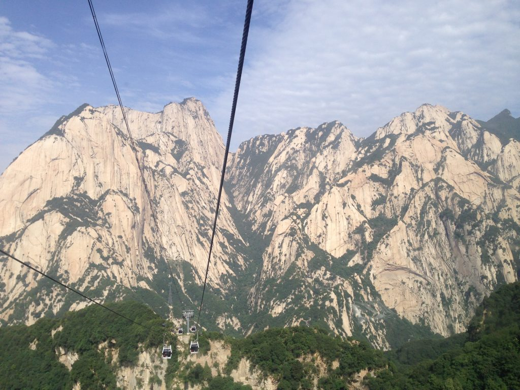 View of mountains from cable car over the valley