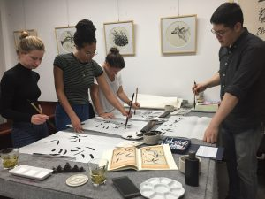 Practicing Chinese calligraphy.