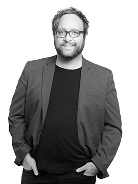 Black and white portrait photo of Joss Kiely