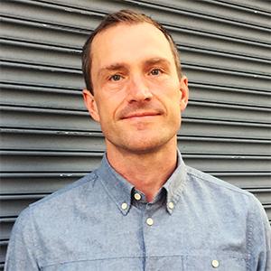 Photo of Jonathan Chapman wearing a button down shirt