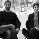 Suresh Perera & Julie Charbonneau sit for a photo in adjacent chairs