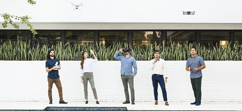 Members of CICADA team pose together in front of a white wall