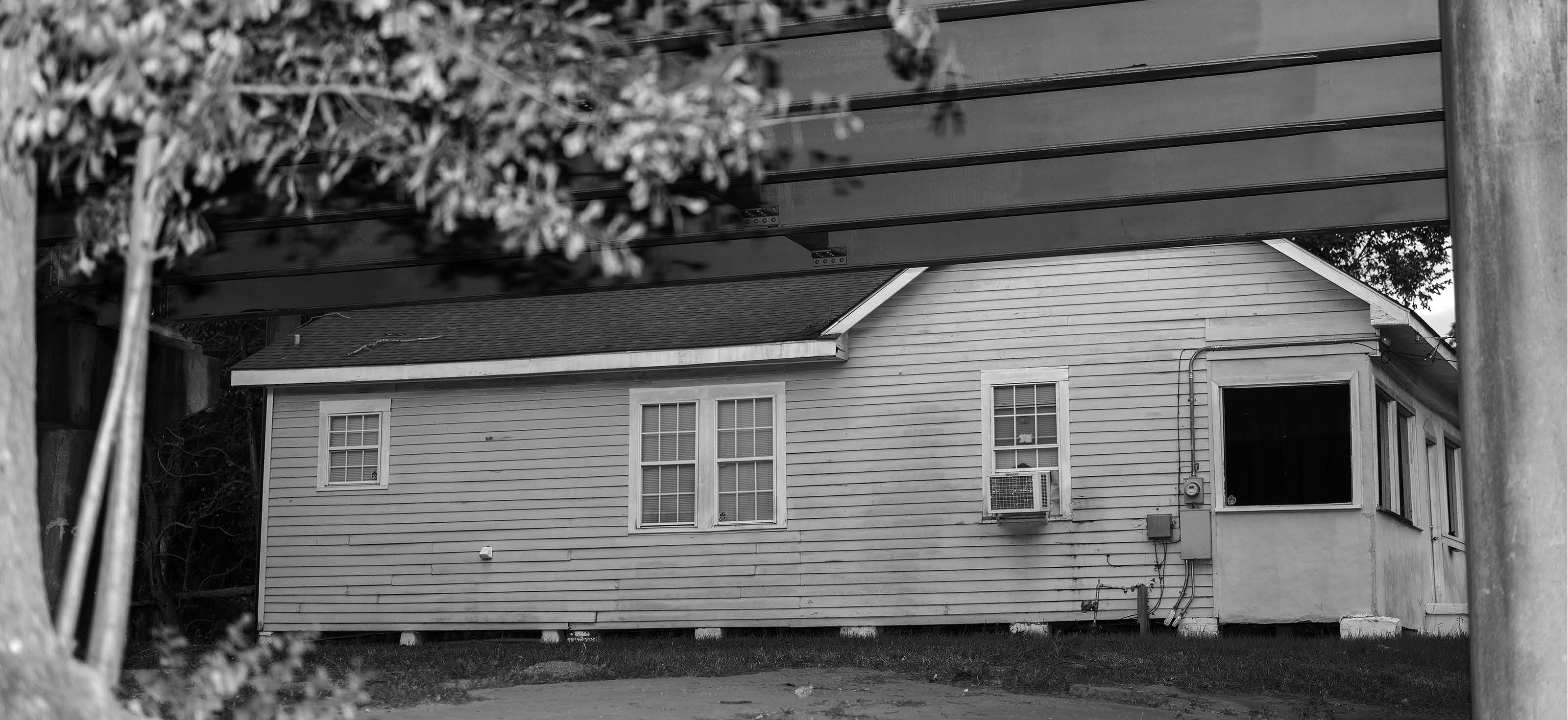 Black and white photo of the side of a house