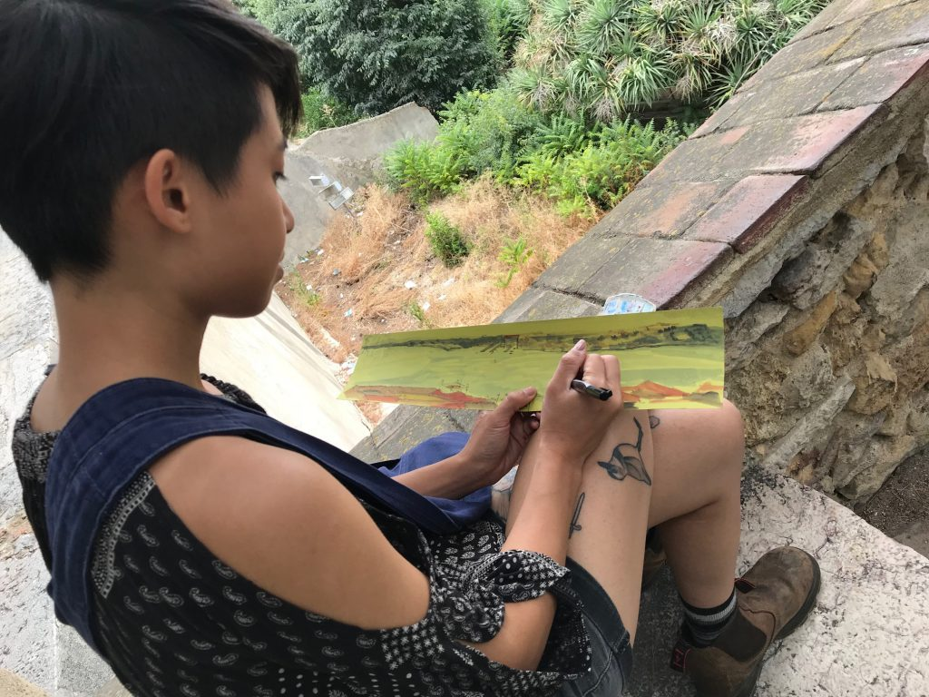 Art student sketching a scene