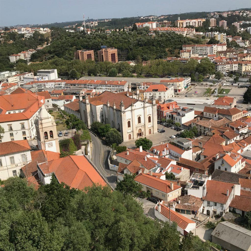 Overheard view of orange rooftops in city