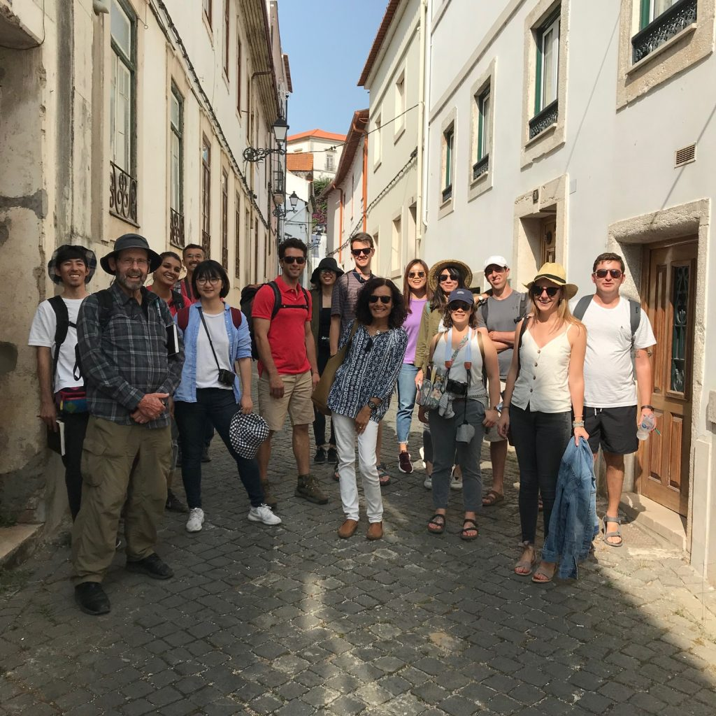 Students pose for picture on a street in Portugal