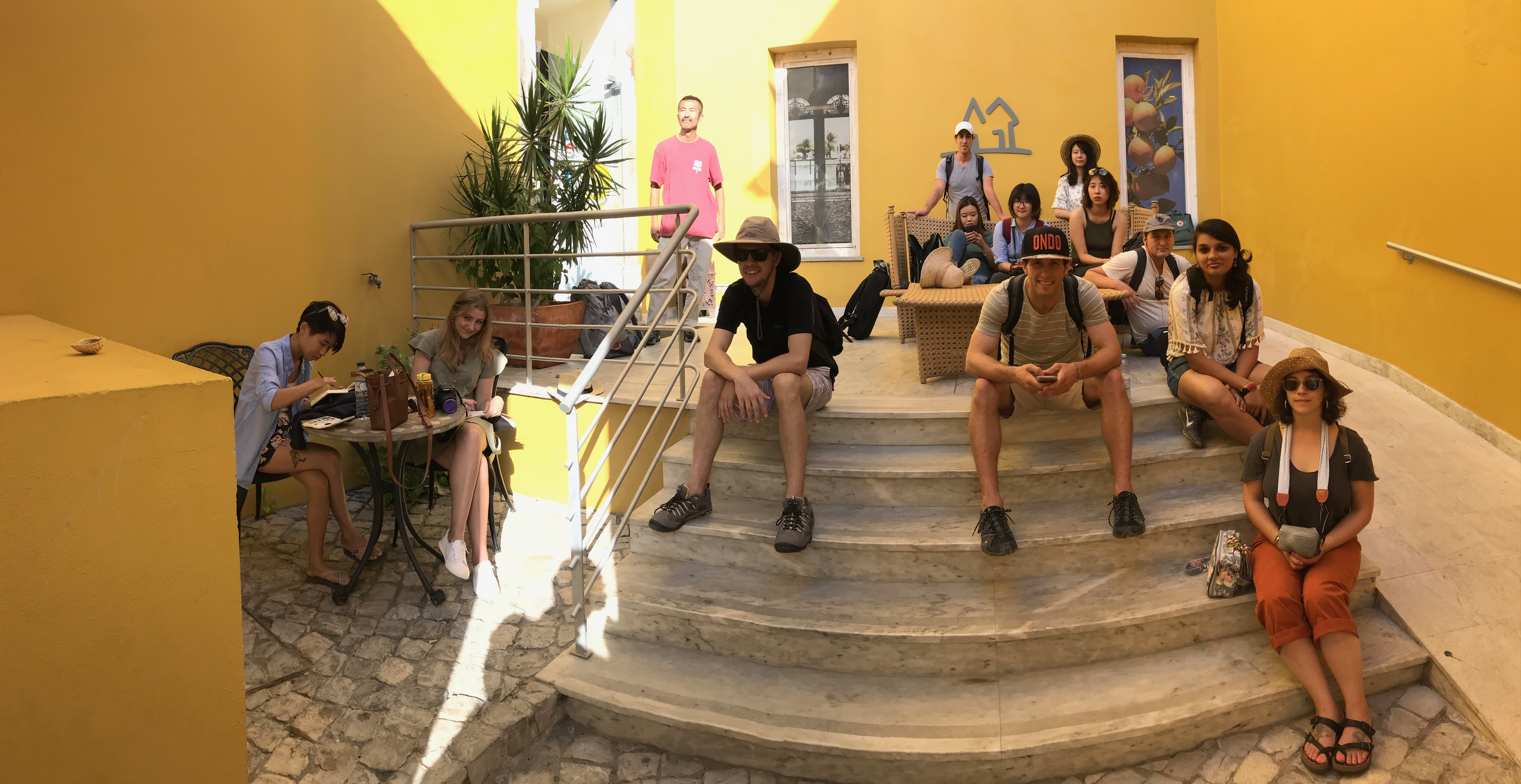 Group of students sit on steps