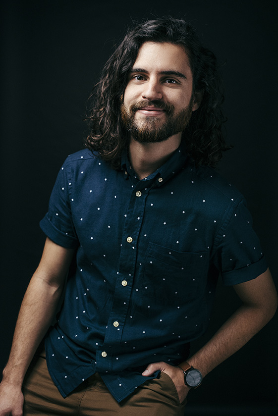 Photo of James Catalano with beard and long dark hair