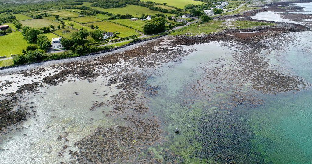 Figure in sea of Ireland coast