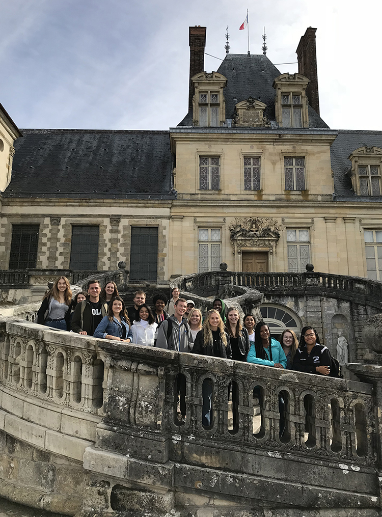 Students on Fontainebleau grand staircase