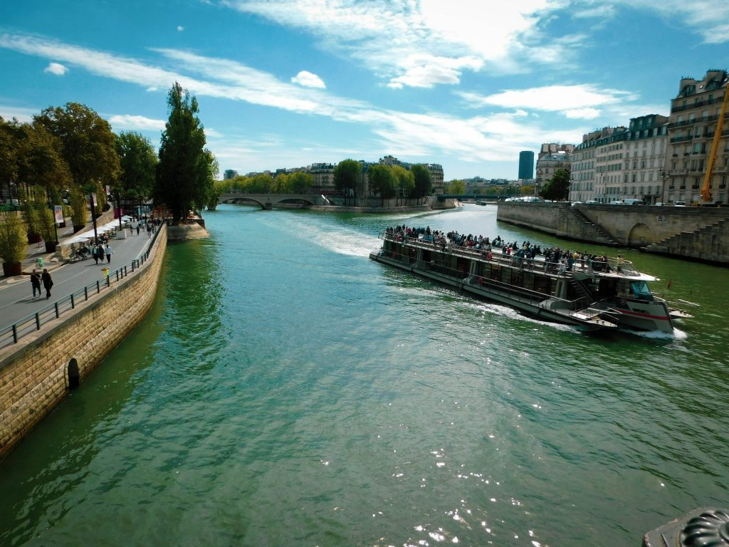 Boat on Seine River, water shining in the sun