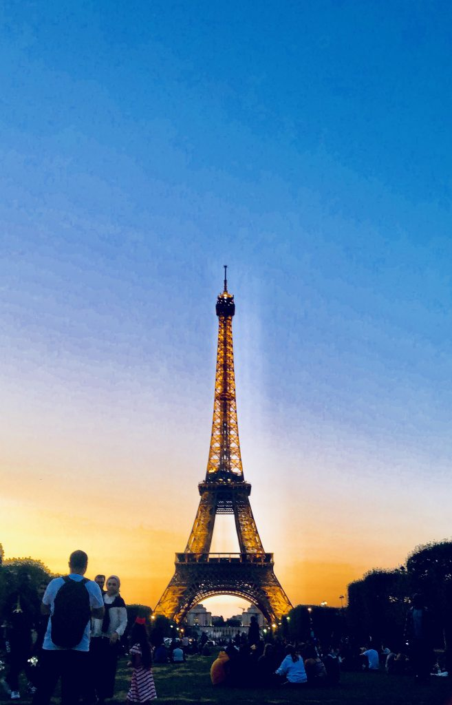 Eiffel Tower with sunset sky yellow and blue