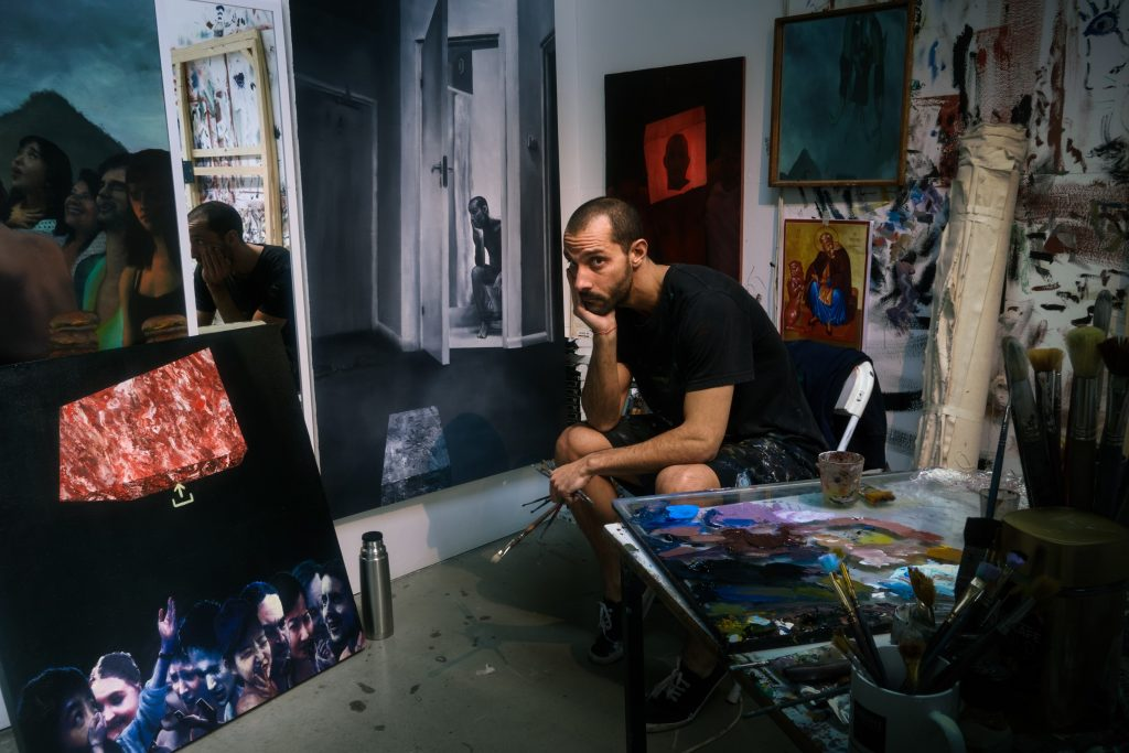 Man with paintings