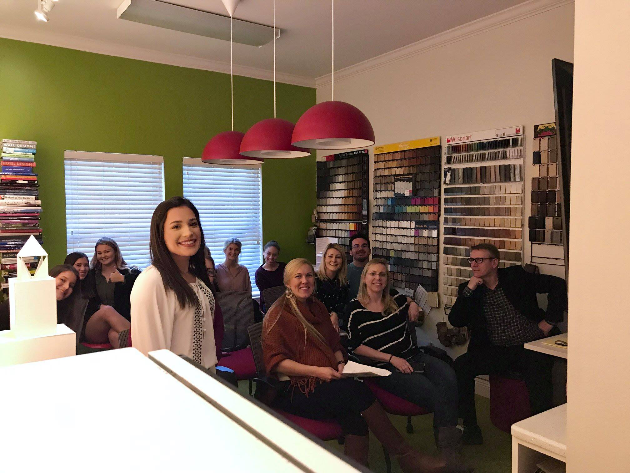 Smiling interior designers in office