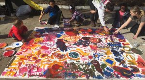 Students and kids paint bright colors