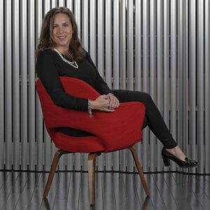 Woman in red chair