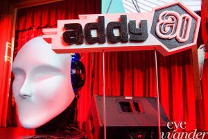 ADDY Awards stage with red curtain, statue