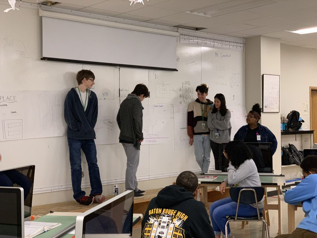 Students by whiteboard