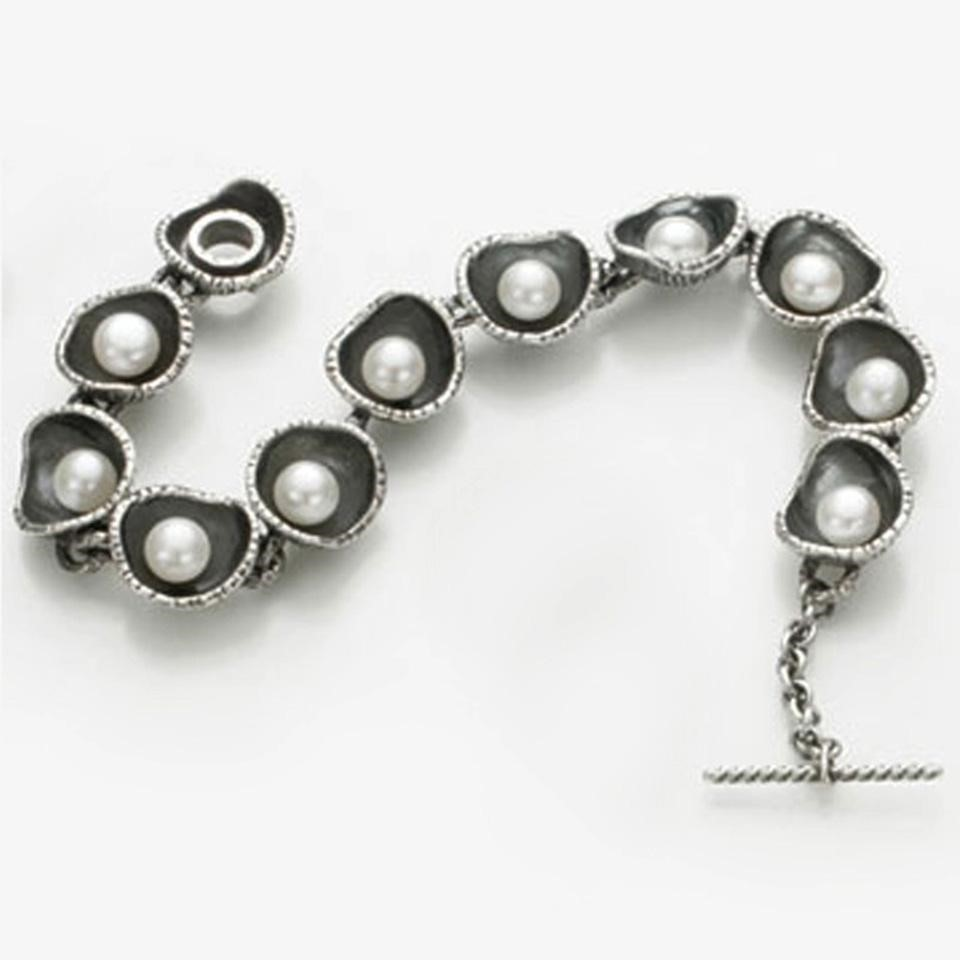 Bracelet with oyster shells containing pearls