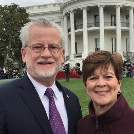 Reid Falconer and wife, White House in background