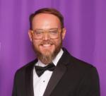 Charles Neyrey in tux, purple background