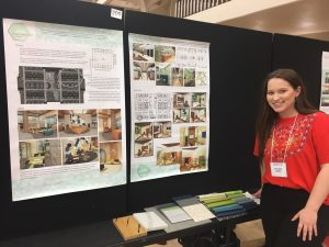 Female student by poster presentation
