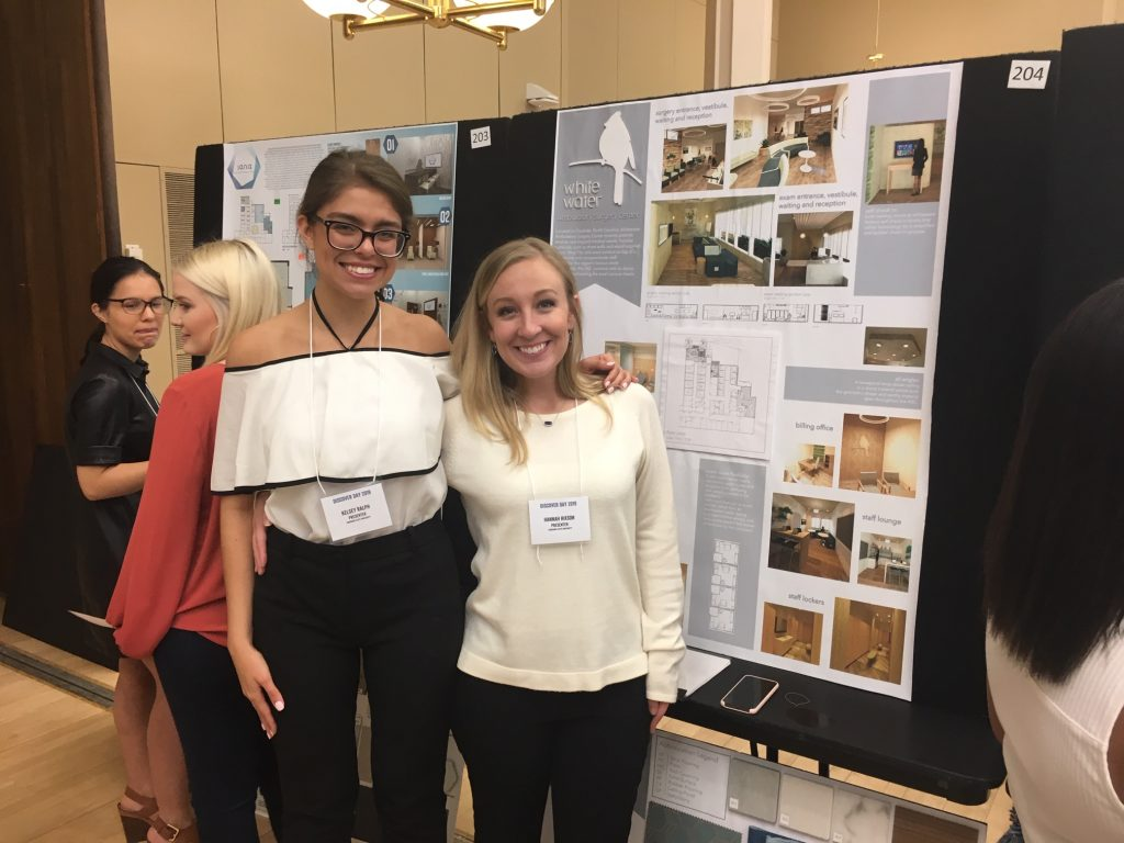 Interior design students by their presentations