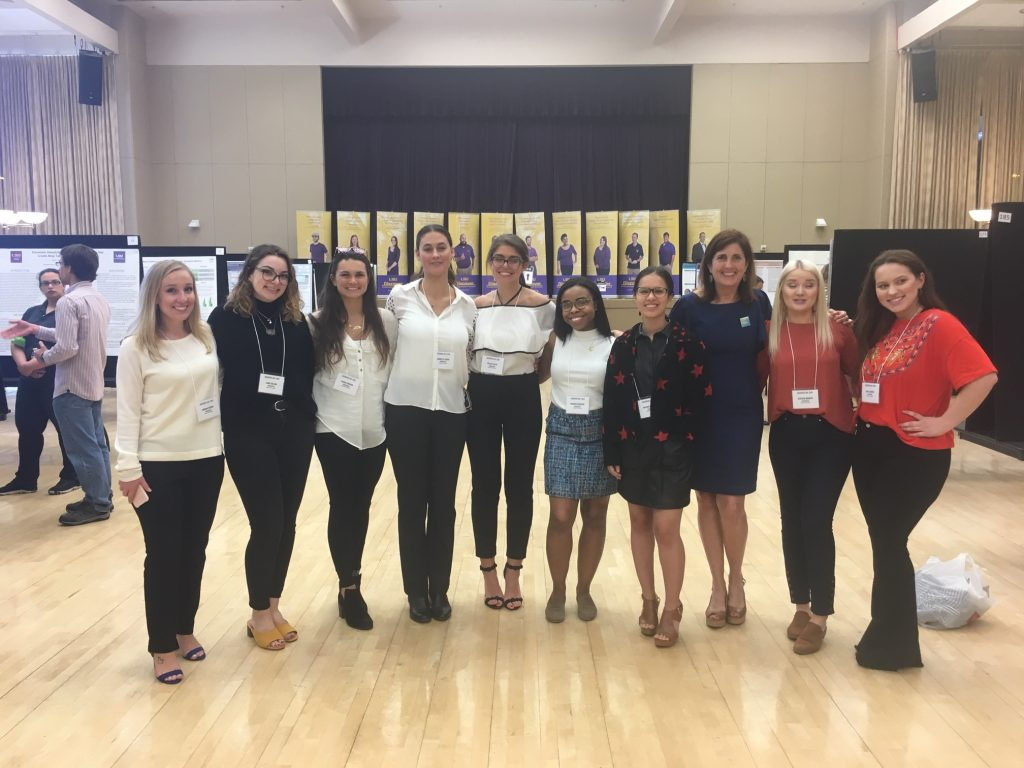 Students pose, smilig, at LSU Discover Day