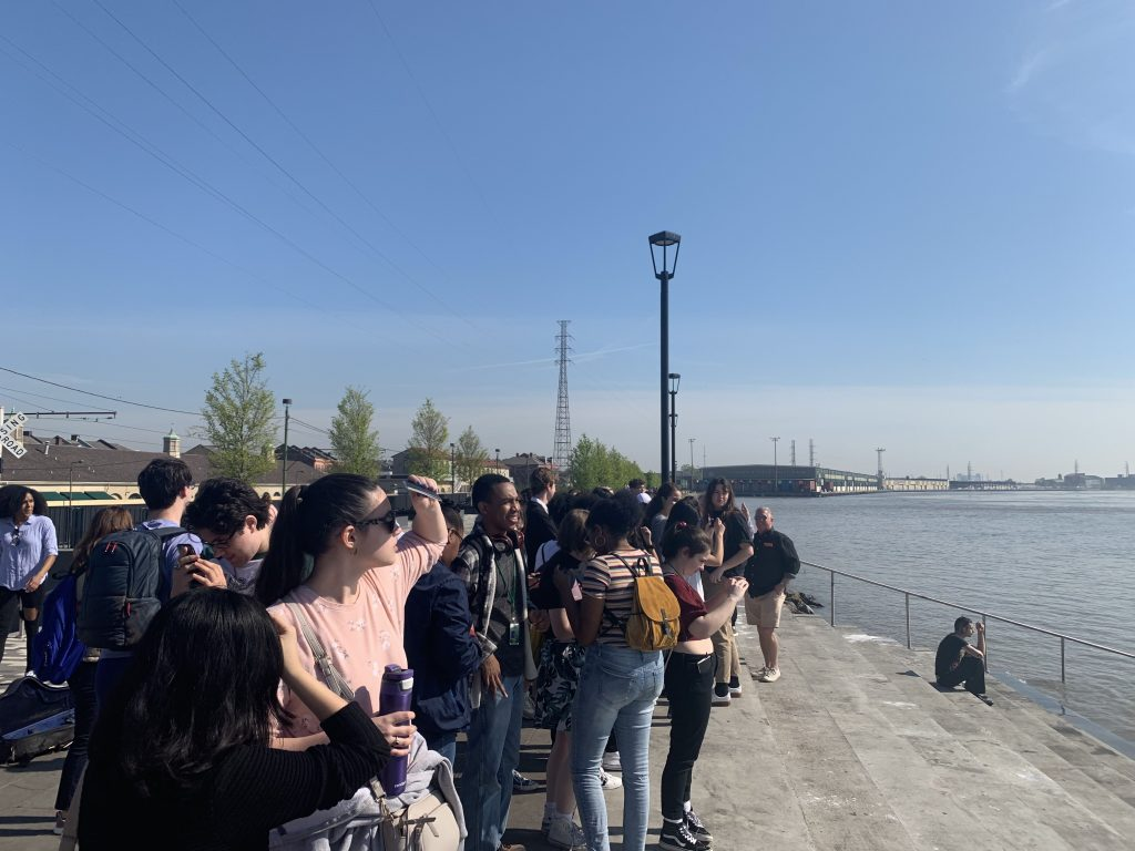 People stand by river