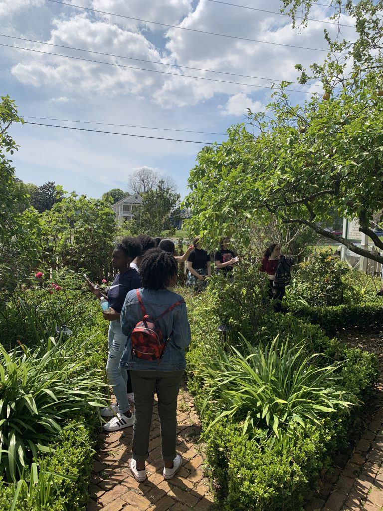 Students in lush garden