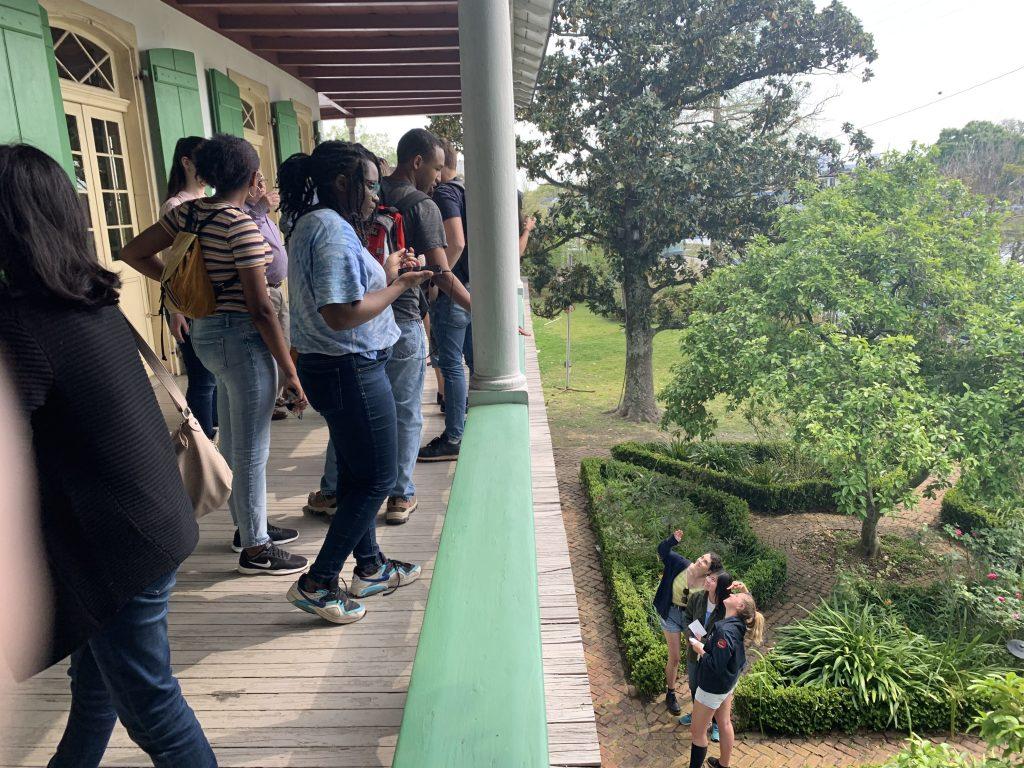 Students on balcony overlooking green garden