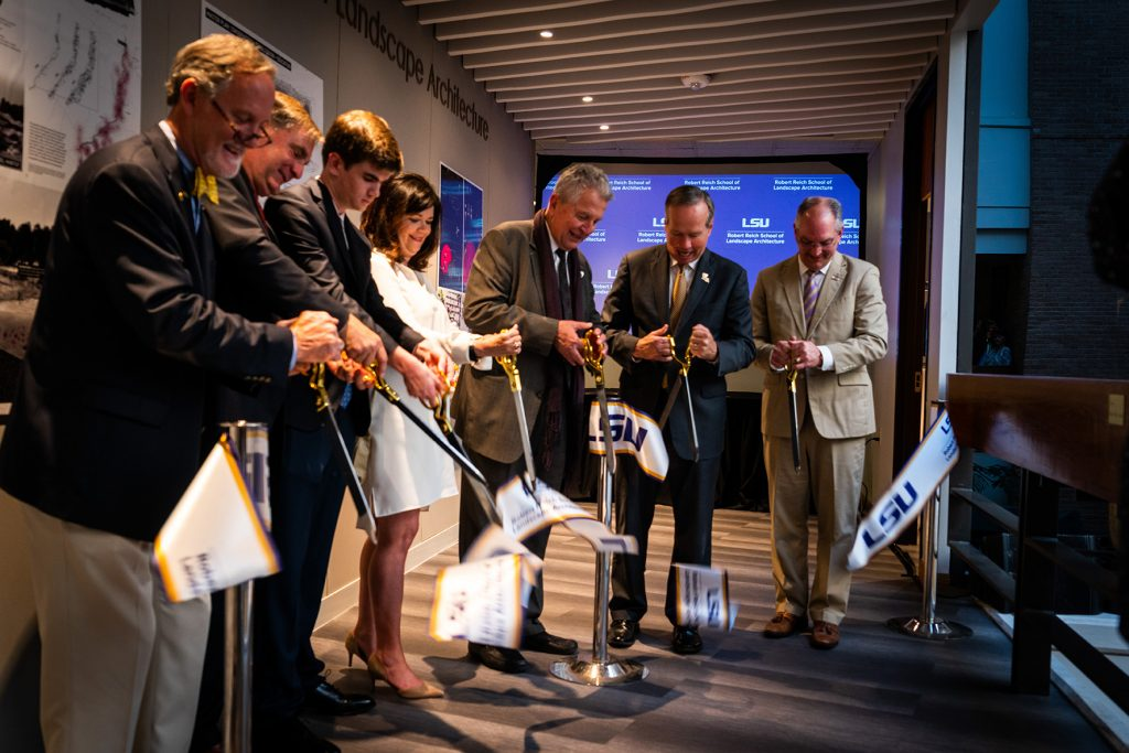 Ribbon cut, falling to floor