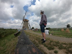 Young man by windmill