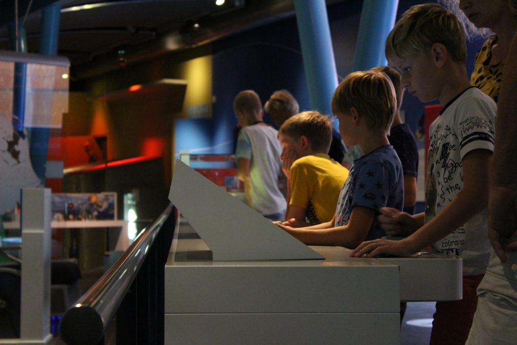 Children at interactive exhibit in