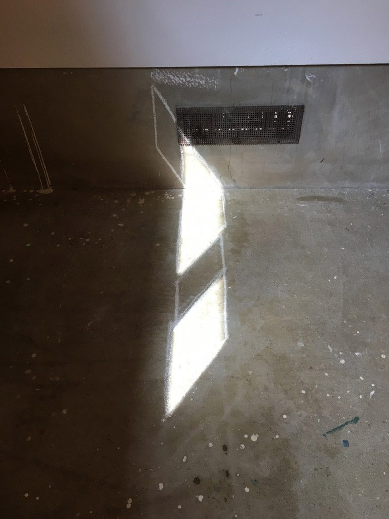 Squares of light on floor