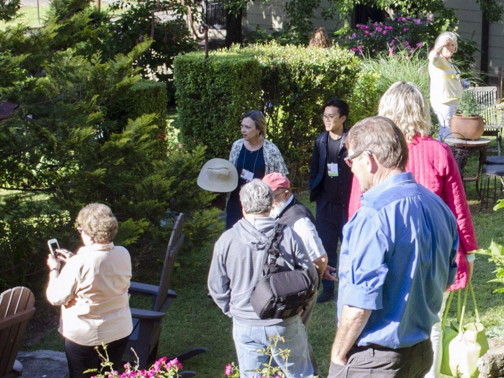 People observe greenery in garden