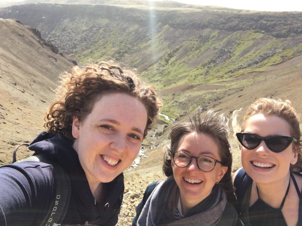 Three women by Icelandic gorge